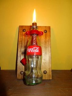 Re-purposed Coca-Cola Bottle Oil Lamp on Reclaimed barn wood plaque