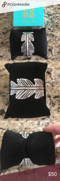 """Rustic Cuff of the Month Silver Textured Feather March 2017 Cuff of the Month. Silver plated. Measures 5"""" around. Comes with rustic cuff box and black storage pillow. Rustic Cuff Jewelry Bracelets"""