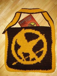 I will read these books, and then craft to my heart's desire.  This page shows a bunch of Hunger Games projects.