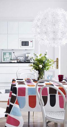 Colorful table cloth looks fresh in white surroundings. Marimekko, Rainbow Kitchen, Yellow Houses, Scandinavian Interior, Home Hacks, Kitchen Interior, Kitchen Design, Luxury Furniture, Modern Interior Design