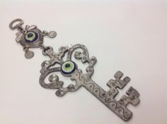 Evil Eye Wall HangingKey home decor with evil eye por EvilEyeHome, $15.00