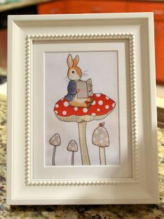 book pages in frames for tables. - I had a lot of fun finding simple illustrations from classic children's books, and they looked great on the tables for Jen's baby shower! Got loads of compliments!