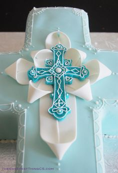 "Cute way to ""dress"" the cross, using my FHC cross mold instead...(Christening Cross Cake by TheSweetestThingCS, via Flickr)"