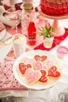 Pink and Red Valentine's Day Heart Sugar Cookies with Sprinkles.