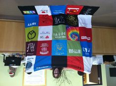 Perri Nitzberg displaying her almost completed tee shirt quilt.  She and her mom always do a craft project together while Perri's home.  This is the very first quilt.  Well done!