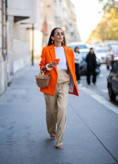 Chloe Harrouche wearing orange blazer beige pants Wandler bag is seen outside AWAKE Awake during Paris Fashion Week Womenswear Spring/Summer 2019 on. Orange Blazer Outfits, Camel Pants Outfit, Beige Outfit, Beige Blazer, Moda Fashion, Fashion Pants, Orange Hose, Mode Orange, Blazer Outfits
