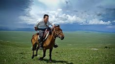125 years of National Geographic: 2009, northern Mongolia: the research scientist and National Geographic emerging explorer Dr Albert Lin gallops across the steppe as he searches for Genghis Khan's tomb and other archaeological sitesPhotograph: Mike Henning/National Geographic