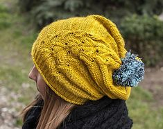 """""""Jollyoly"""" is a slouchy style hat that features an interesting lace motif rising up on one side."""