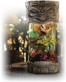 ALOHA TIKI AQUARIUM  We're big fans of aquariums, but it's somewhat difficult to find original-looking setups. The Aloha Tiki Aquarium ($430) is anything but ordinary, with a cylindrical aquarium inside of a carved, detailed Tiki statue. It comes with all the necessary components to create a salt-water environment including synthetic sea salt, sand, and a submersible heater, and can also be ordered for freshwater fish if desired. Never have a boring aquarium again.