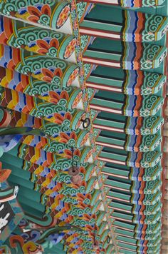 The colors of Korea...  We call it Dan-Cheong.  [the name of the art of painting roofs, per Wikipedia.]  in Tong-Young city, of South Korea, photo by Holly, the blogger of Beyond Kimchee