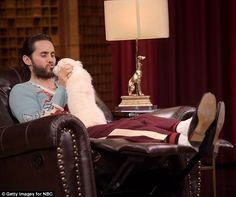 Adorable: Jared Leto gave a puppy a kiss during an appearance on The Tonight Show With Jimmy Fallon on Monday night