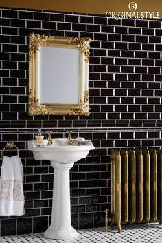Wall tiles by Original Style, Artworks Range, Jet Black Metro. Add interest with classy mouldings, skirting boards and corner pieces. Nowadays these are more decorative than functional, adding an attractive transition between surfaces in your bathroom or kitchen. These wall tiles look great with an octagon and dot mosaic floor.