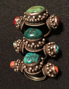 Three Tibetan hair rings. Silver, turquoise, coral. 19th c. Private collection