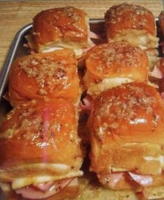 Hot Ham Cheese  16 Dinner Rolls or Hawaiian rolls  24 slices Honey Ham 16 slices Cheese ¼ C Mayo 1½ Tbsp Dijon Mustard 8 Tbsp butter, melted  1 tsp onion powder  ½ tsp Worcestershire 1 Tbsp poppy seeds ¼ C brown sugar On bottom half of rolls top with 1 1/2 slices of ham and 1 slice of swiss cheese. Spread 1 tsp of mayo on top-half of roll  Mix mustard, butter, onion powder, Worcestershire, poppy seeds, and brown sugar. Pour over rolls. Bake for 20 minutes, until cheese melts.