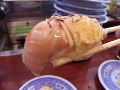 -Kurazushi- It's a conveyer-belt sushi chain popular. Cheese seared salmon $ 1.05 http://alike.jp/restaurant/target_top/593872/