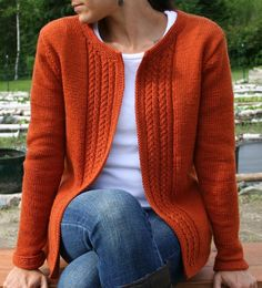 "Casual cardigan features sharp cable panels that run along the center opening. Knit in pieces, set in sleeves, relaxed fit.The cardigan is shown is size 36"" with +3"" ease on the model.Approx. yardage:1353 (1476, 1599, 1599, 1722, 1845, 1968) yards."
