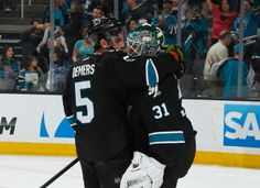 San Jose Sharks defenseman Jason Demers hugs Sharks goaltender Antti Niemi after a 6-3 Sharks win over the Los Angeles Kings (April 17, 2014).