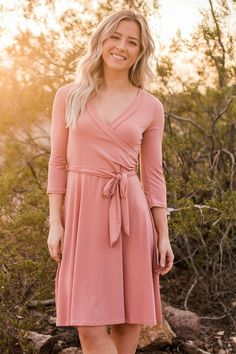 Our popular maxi wrap dress is now available in a knee length version! This chic faux wrap dress will become the new staple of your wardrobe!