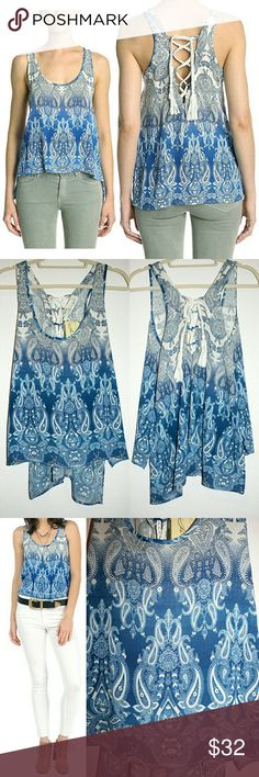 Lace-Up Back Ombre Paisley Swing Tank NWT This beachy boho swing tank from Vintage Havana is so gorgeous! I love the intricate paisley pattern and deep blue to cream ombre gradient coloring - not to mention the beautiful lace-up back with a soft, chunky rope tie closure! It also features a scoop neckline, high-low hemline, and has a very flattering drape! The super soft fabric is 100% rayon. I'm happy to provide measurements upon request! Vintage Havana Tops Tank Tops