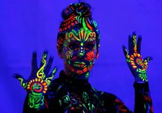 A model displays ultraviolet light paint during the World Bodypainting Festival in Poertschach, Aust... - REUTERS/Heinz-Peter Bader