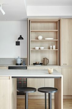 Our Manteau residence kitchen is cool and understated with soft, tonal custom joinery, challenging the expectations of small space living. Small Space Living, Small Spaces, Ocean House, Flat Ideas, Kitchen Sink Faucets, Wine Storage, Storage Ideas, Updated Kitchen, Joinery