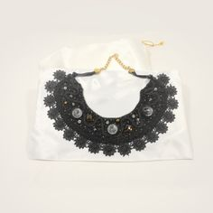 Black statement necklace in wool with glass cabochon, crystal beads, ribbons and lace. OOAK.  https://www.facebook.com/SaltieCreations  https://www.etsy.com/listing/214784500/black-statement-necklace-in-wool?  #blacknecklace #statementnecklace #etsy