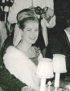 Princess Grace seated with Prince ( at the time ) Juan Carlos