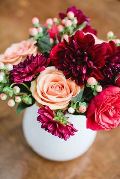Peach and Cranberry Centerpiece- I like the cranberry flowers. Could also be done in navy blue