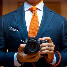 orange knitted tie, navy blazer, paisley pocket square, wide spread collar, dslr