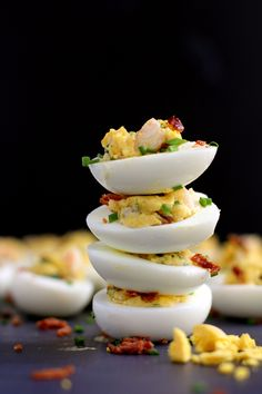 A dressed up version of your favorite Easter appetizer.  The traditional deviled egg goes upscale with the addition of shrimp and bacon, becoming an instant dinner favorite.  Double the recipe, my friends.  These Shrimp and Bacon Stuffed Deviled Eggs are going to go fast.