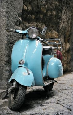 Classic Italian Vespa scooter in the street