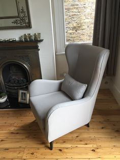 J Brown cotton, Harbour (colour 35 - dove) was used on this modern gentlemens' club chair.