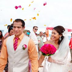Pink and orange flowers thrown as we walk down the aisle!