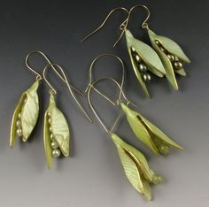 Judy Dunn's polymer clay jewelry.  Wonderful subtlety of patterns in the shimmering pods