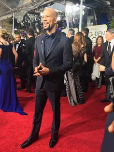 Winner, Common at the 72nd Annual Golden Globe Red Carpet