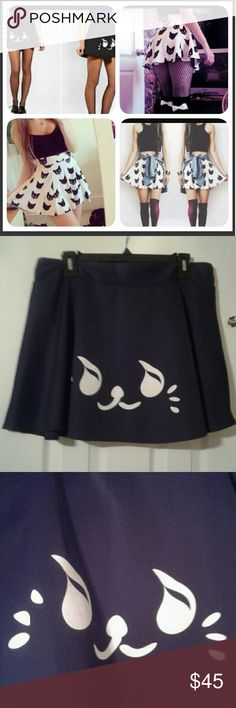 From dolls kill  Adorbs kitty scater skirt Get the look! Cute prestine, fits Med,large,xl not marked no tag but elastic waist and plenty of give...* trade value $65* dolls kill  Skirts Mini