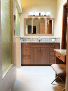 As part of this master bathroom remodel, designer Connie Wyland of Wyland Interior Design Center used PentalQuartz in the Sandcastle color as part of her design to create an open airy feel. Cabinets from DeWils Custom Cabinetry.