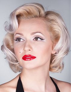 A medium blonde wavy coloured platinum white Iconic hairstyle by Web Collections