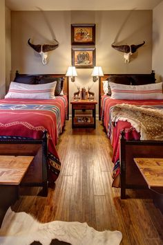 Large, heavy antlers make a strong visual impact in this lodge-style bedroom. Southwestern-style bedding and artwork complete the look.