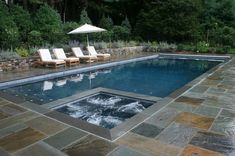 This one, with a wall fountain to the left in reclaimed brick and just grey blue tile, not the slate would be my fantasy pool.