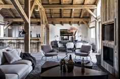Living space with wooden ceiling and exposed beams in a rustic chalet