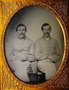 Extremely rare HALF plate ambrotype of two unknown Confederate brothers. Both of these men are dressed in Columbus Depot jackets with the collars and cuffs trimmed in the Columbus Depot fashion. The brother to the left has a book tucked into his arm which I would assume is a bible.