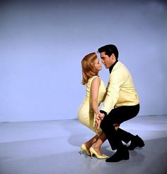 Ann-Margret and Elvis looking charmingly sweet in matching yellow ensembles.