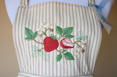 Chef's apron embroidered with cheerful strawberry motif, by NestingInstinctShop, $35.00.  Heavy tan/cream pillow ticking fabric made completely by us  designed to please the serious chef!