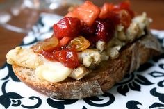 Delicious Apple and Cherry Chutney is served atop walnut-crusted Brie and baguette toasts.