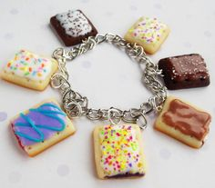 the bracelet chain is about 7 1/2 and comes with the seven pop tarts shown in the pictures :)    if you want different kinds of pop tarts just
