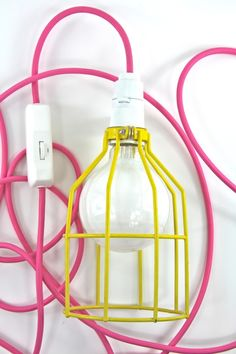 This is a cage light pendant with a 3m cord length, wall plug and dimmer.Name: 'Miami'.Cord: Pink, 3m.Cage: Standard Yellow.Lamp holder: White, E27 Screw-In.Plug: White, Three Pin.Additions: White, Dimmer.Light bulb not included. (Note: Plumen Bulbs cannot be dimmed).The cage measurement: Height: 190mms Diameter: 120 mm.Enjoy your pendant by:- Hang from a ceiling as a pendant over a counter or a bar (swap the plug for a ceiling rose).- Use as a wall light, looped over a wall or ceiling hook…