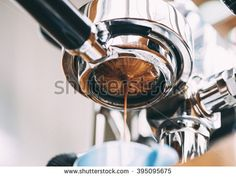Delicious fresh morning espresso coffee with beautiful tiger crema pouring through the bottomless portafilter