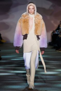 Marc Jacobs, New York Fashion Week Fall 2014. Chubby faux fur in gradient pastels, ribbed extended v-neck sweater in cream colour with matching long, thin scarf, ribbed leggings and hair band to match, knee length lavender skirt with extended split.