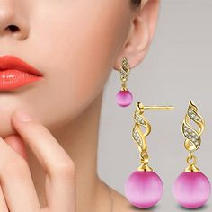 """Specification:  This is a shiny and attractive earrings.  18k gold plated in spiral pattern, it is very eye-catching.  It is a good gift for your lover, family, friend or coworker.    Type: Earrings  Gender: Women's  Theme: Beauty  Style: Fashion  Material: 18k Gold Plated, Zircon, Faux Pearls  Occasions: Wedding, Banquet, Party, Daily Life  Features: Piercing Jewelry, Elegant, Gift, Luxury  Length: 2.7cm/1.06"""" (Approx.)    Notes:  Due to the light and screen setting difference, the item's…"""